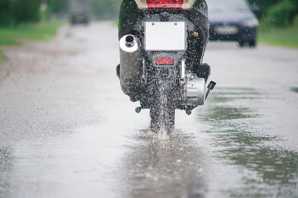 Motorcycle driving through puddles