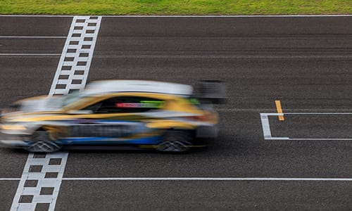 A car driving quickly on a race track