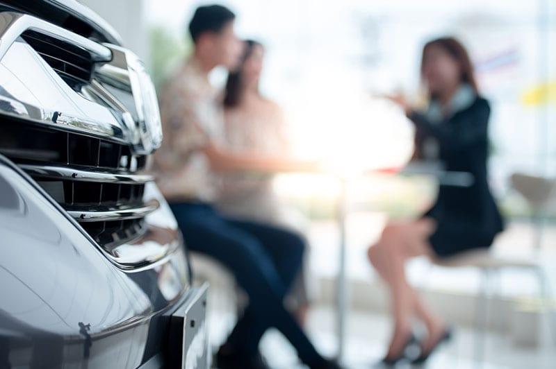 A couple sat in a car dealership