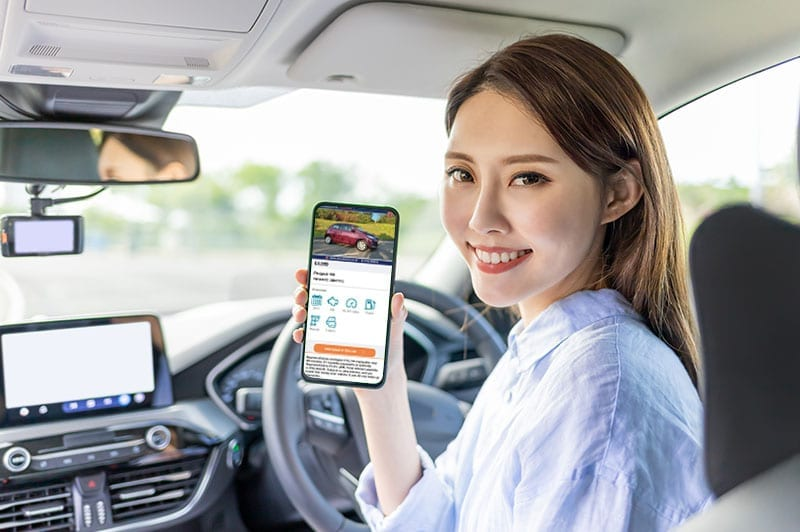 A lady looking at a vehicle advert on her phone